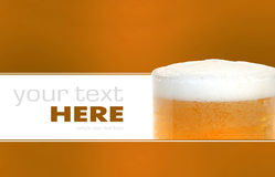 Glass of beer closeup with froth. Isolated on a background Royalty Free Stock Image