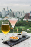 Glass of beer and cocktail with snack Royalty Free Stock Photography