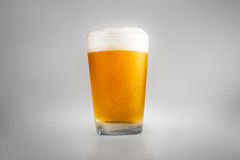 Perfect glass of cold beer with collar. Cold glass of beer. Lager with drops stock images