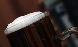 Glass of beer. Cold glass of beer with a nice foam stock images