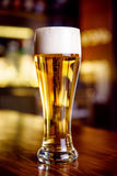 A glass of beer on counter Royalty Free Stock Image