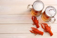 Glass beer with crawfish on light wooden background. Beer brewery concept. Beer background. top view with copy space Stock Images