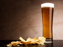 Glass with beer and crisps Stock Photo