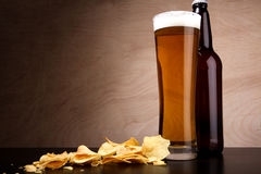 Glass with beer and crisps Stock Photography