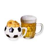 Glass of beer and crisps  on  white background. Royalty Free Stock Photography