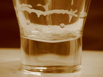 Glass with beer. Cup half filled with beer Stock Photos