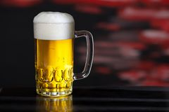 Glass of beer. On the dark background royalty free stock image