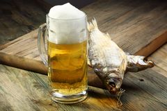 Glass with beer and dried fish. Royalty Free Stock Image