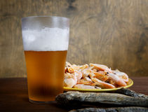 Glass of beer with dried fish Royalty Free Stock Photo