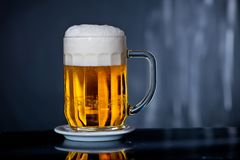Glass of beer. With drops of water stock images