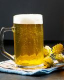 Glass of beer filled to the brim. On a dark background stock photos