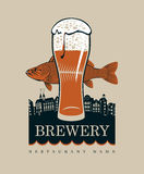 Glass of beer and a fish. Banner with a glass of beer and a fish on a background of the old town Royalty Free Stock Image