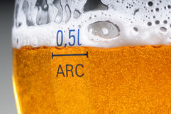 Glass of the beer with foam Stock Photos