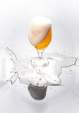 Glass with beer and foam Royalty Free Stock Image
