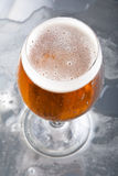 Glass with beer and foam Stock Photos