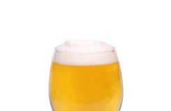 A glass of beer with a foam. On a white background Royalty Free Stock Photos