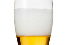 Glass of beer with foam on white Stock Photo