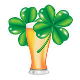 Glass of beer and four leaf clover Stock Images