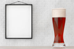 Glass of Beer in front of Brick Wall with Blank Frame Royalty Free Stock Photos