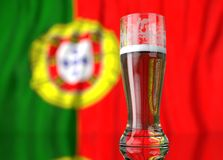 a glass of beer in front a portuguese flag. 3D illustration rendering Royalty Free Stock Photography