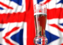 a glass of beer in front a united kingdom flag. 3D illustration rendering. Royalty Free Stock Photo