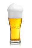 Glass of beer with froth. Isolated over white background royalty free stock photography