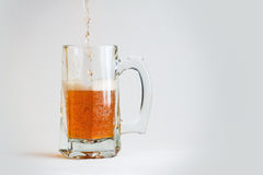 Glass of beer. Isolated on white background Royalty Free Stock Photography