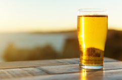 Glass of beer. Glass of beer on the sunset royalty free stock photography
