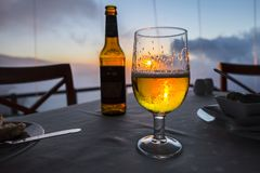 Glass of beer on a table royalty free stock photo