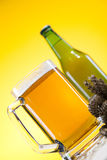 Glass of beer with grain Stock Photo