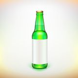 Glass beer green bottle and label. Product packing. Royalty Free Stock Images