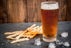 Glass of beer with grissini Stock Photos