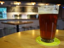 A glass of beer and a hamburger. Beautiful and delicious food, foamy beer in a glass.  Details royalty free stock photo