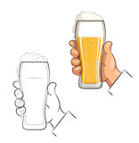 Glass of beer in hand Royalty Free Stock Photo