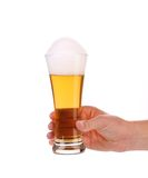 Glass of beer in hand. Royalty Free Stock Photos