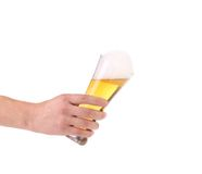 Glass of beer in hand. Royalty Free Stock Photo