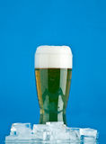 Glass of beer with ice Royalty Free Stock Images