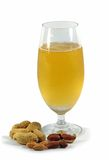 Glass of beer and peanuts. Glass of beer isolated on white background royalty free stock photo