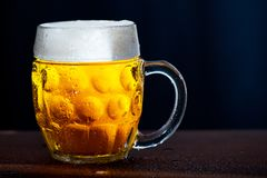 Glass of beer. With drops of water stock photos