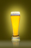 Glass of beer isolated. On a yellow background Stock Images