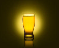 Glass of beer isolated. On yellow background Stock Images