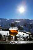 Glass of beer or lager on wall in the Sierra Nevada Ski resort i Stock Images