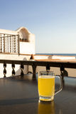 Glass of beer with lemon near the sea. Stock Photo
