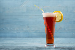 Glass of beer with lemon and sipper royalty free stock photography