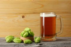 Glass beer on light wooden background. Beer brewery concept. Beer background Royalty Free Stock Photo