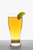 Glass of beer with lime Royalty Free Stock Photos