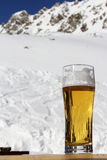 Glass of beer in mountain cafe Stock Image