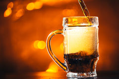 Glass beer mug on a blurred background Royalty Free Stock Image