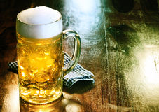 Glass beer mug with golden ale or draft Royalty Free Stock Images