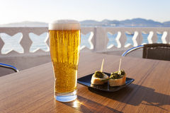 Glass of beer near the sea. Royalty Free Stock Image